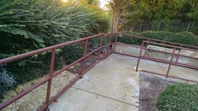 three line Custom steel railings with round ADA ends