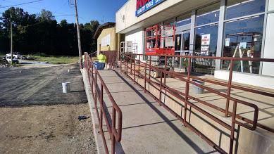 three line ADA bottom of wheelchair ramp handrail.
