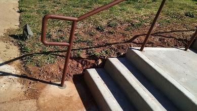 ADA bottom of stair rail.