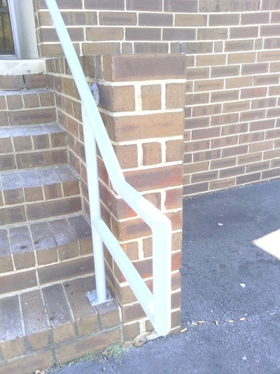 ADA steel railings with baseplate for concrete stairs. 1 1/4 inch (1.5/8 inch OD) steel pipe railings