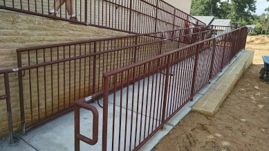 ADA steel ramp railings with ADA bottom ends displayed. This makes for easy handicap access.