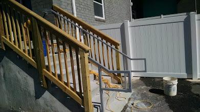 Steel ADA handrails for wood steps