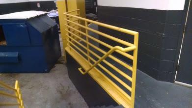 ADA steel handrails welded to steel guardrails on dock