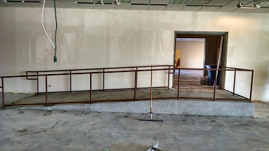 side view of an ada steel pipe railing ramp