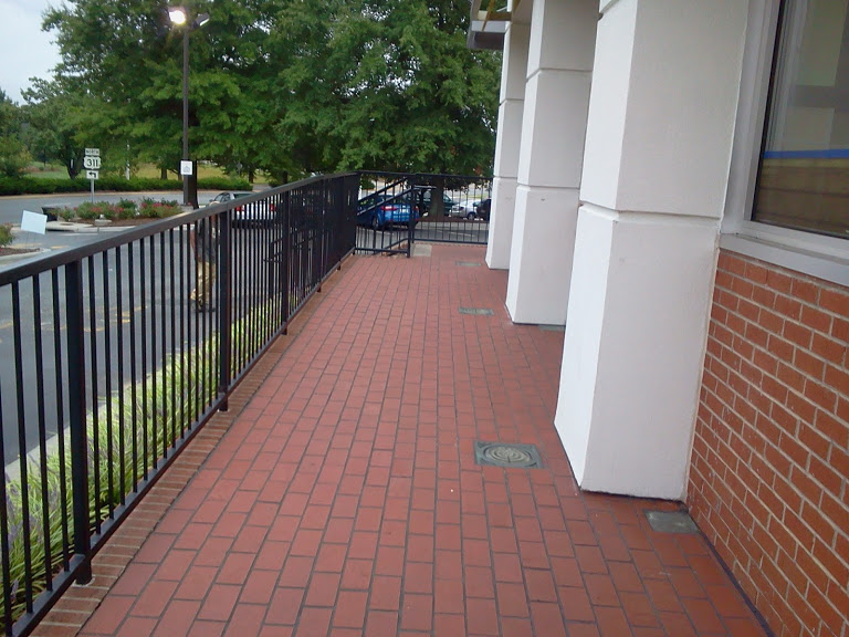 Strait run steel railings with core drilled installation and set in bricks.
